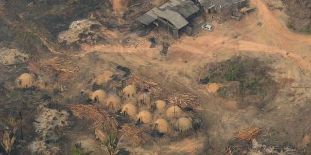 Charcoal-making furnaces and wooden planks are seen from the air, in the city of Jaci Parana, Rondonia state on Saturday. The defense and environment ministers have outlined plans to battle the blazes that have prompted an international outcry as well as demonstrations in Brazil against President Jair Bolsonaro's handling of the environmental crisis. (AP Photo/Eraldo Peres)