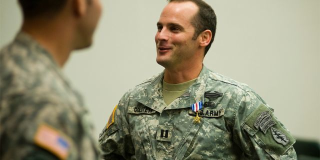 In this photo taken Jan. 4, 2011, U.S Army Capt. Mathew Golsteyn is congratulated by fellow soldiers following the Valor Awards ceremony for 3rd Special Forces Group at Fort Bragg, N.C. (James Robinson/The Fayetteville Observer via AP).