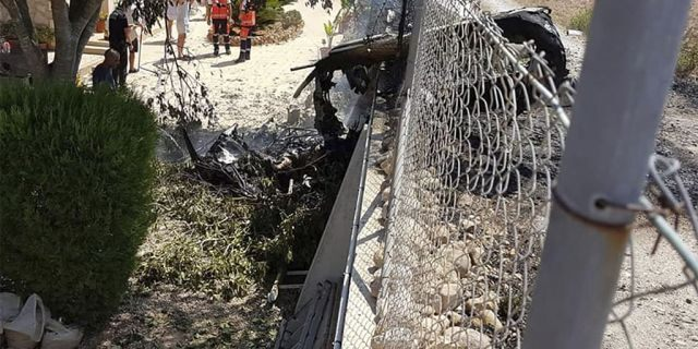 Wreckage by a fence after the crash near Inca in Palma de Mallorca, Spain, on Sunday.