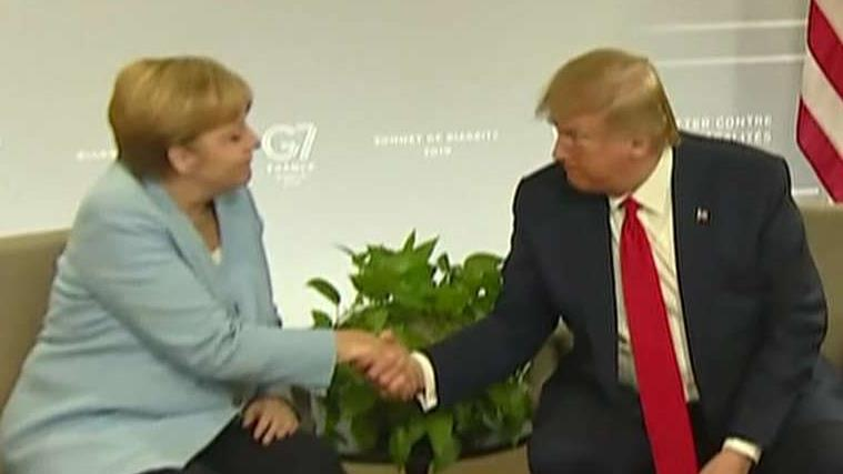 Trump meets with German Chancellor Merkel, strikes bilateral trade deal with Japan at the G7 summit