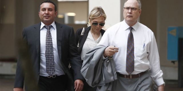 Attorneys Lawrence Hashish, left, David Frankel, right, and paralegal Juliana Marulanda, center, walking into the Broward County Jail on Monday.