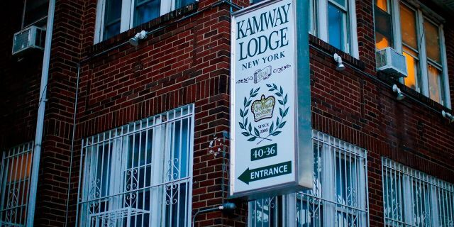 A sign points to the entrance of the Kamway Lodge Thursday, Aug. 22, 2019, in the Queens borough of New York. Police say the body of Andrea Zamperoni, a chef at a popular restaurant in New York's Grand Central Terminal who went missing the previous weekend, was found at the hostel earlier in the day. (AP Photo/Eduardo Munoz Alvarez)