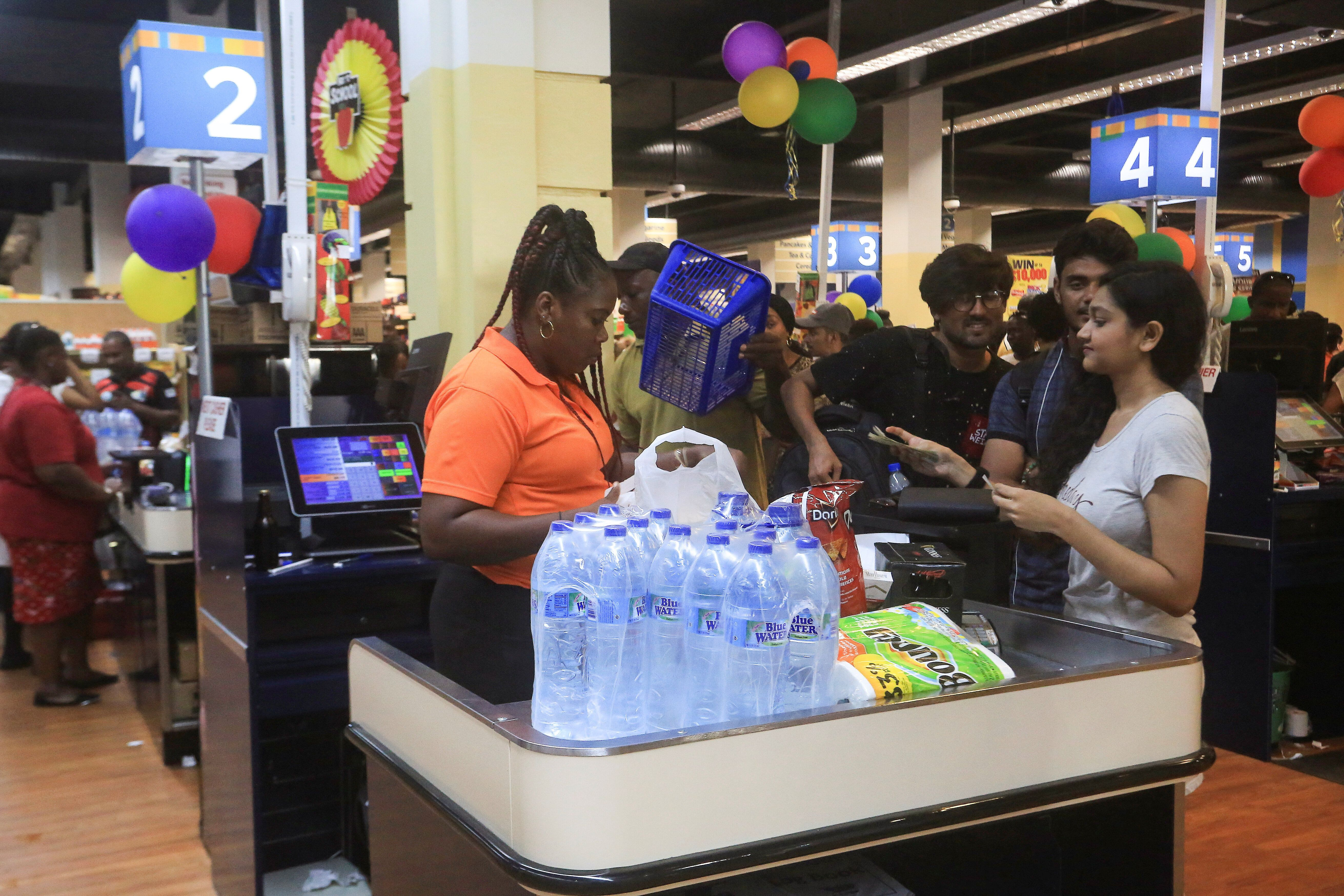 People buy bottled water in preparation for the arrival of Tropical Storm Dorian at a supermarket in Gros Islet, St. Lucia, o