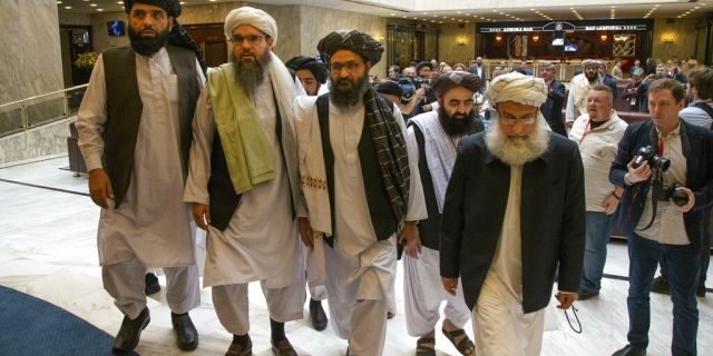 In this May 28, 2019 file photo, Mullah Abdul Ghani Baradar, the Taliban group's top political leader, third from left, arrives with other members of the Taliban delegation for talks in Moscow, Russia.