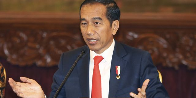 Indonesia President Joko Widodo gestures as he speaks during a press conference at the palace in Jakarta, Indonesia, Monday, Aug. 26, 2019.
