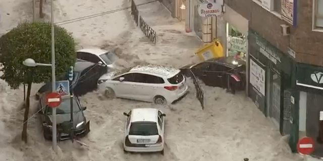 Cars are swept away by floodwater after heavy rainfall hit Arganda del Rey suburb of Madrid, Spain August 26, 2019.