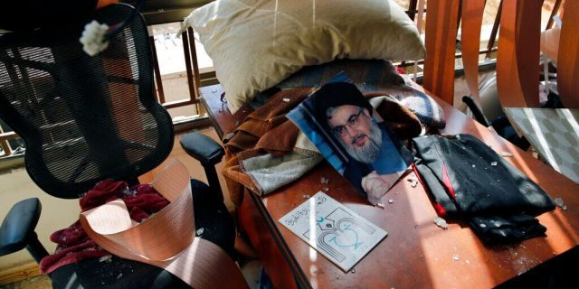 Aug. 25, 2019: Hezbollah leader Sayyed Hassan Nasrallah lies amid other damage inside the Lebanese Hezbollah media office, in a southern suburb of Beirut, Lebanon.