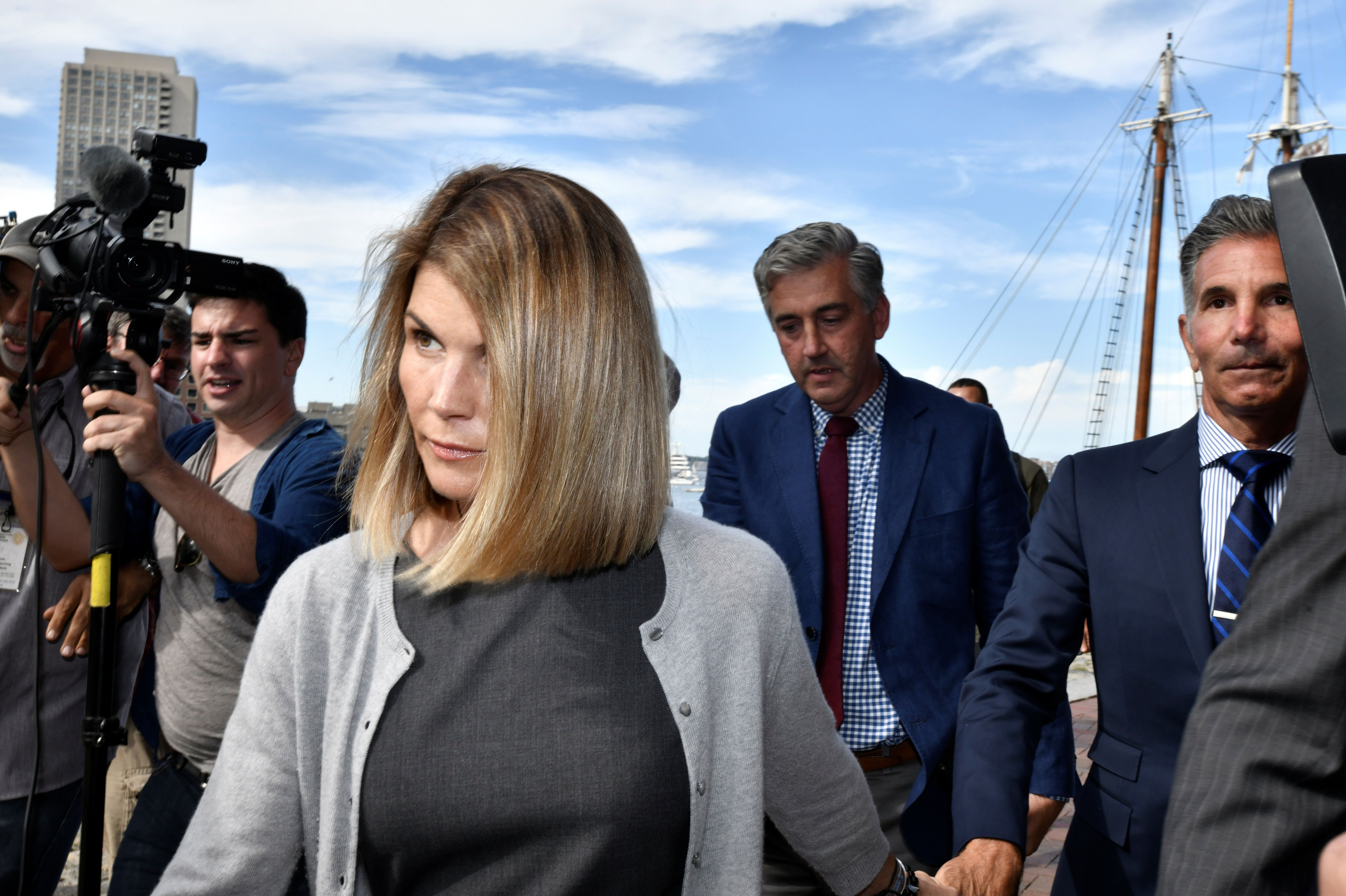 Actress Lori Loughlin, and her husband, fashion designer Mossimo Giannulli leave the federal courthouse after a hearing on ch