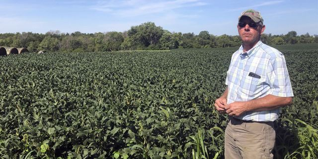"""Farmer Randy Miller said the U.S. has been """"stabbing us in the back."""" (AP Photo/Julie Pace)"""