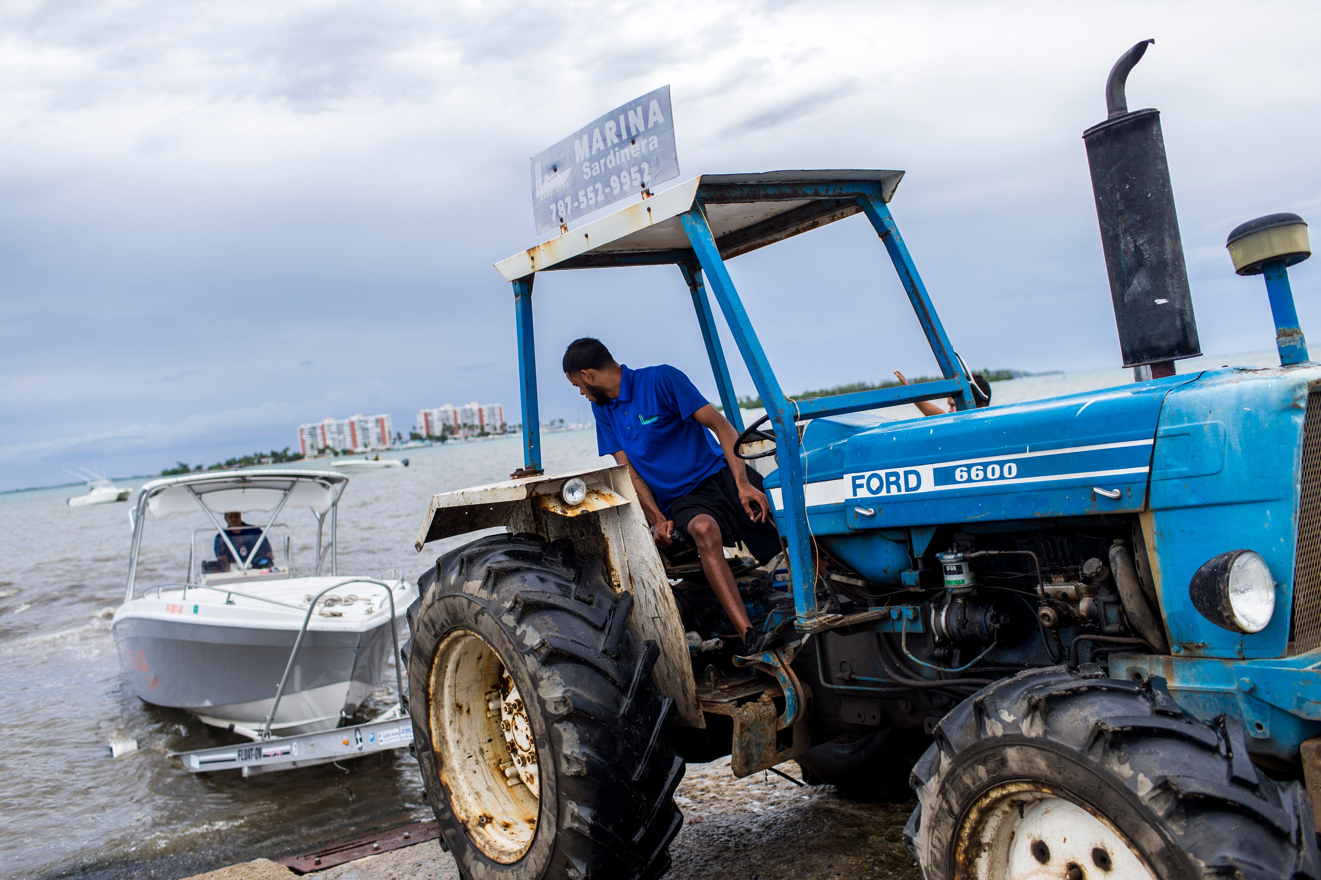 Boat owners prepare to take their vessels out of the water at Sardinera Marina in Fajardo.