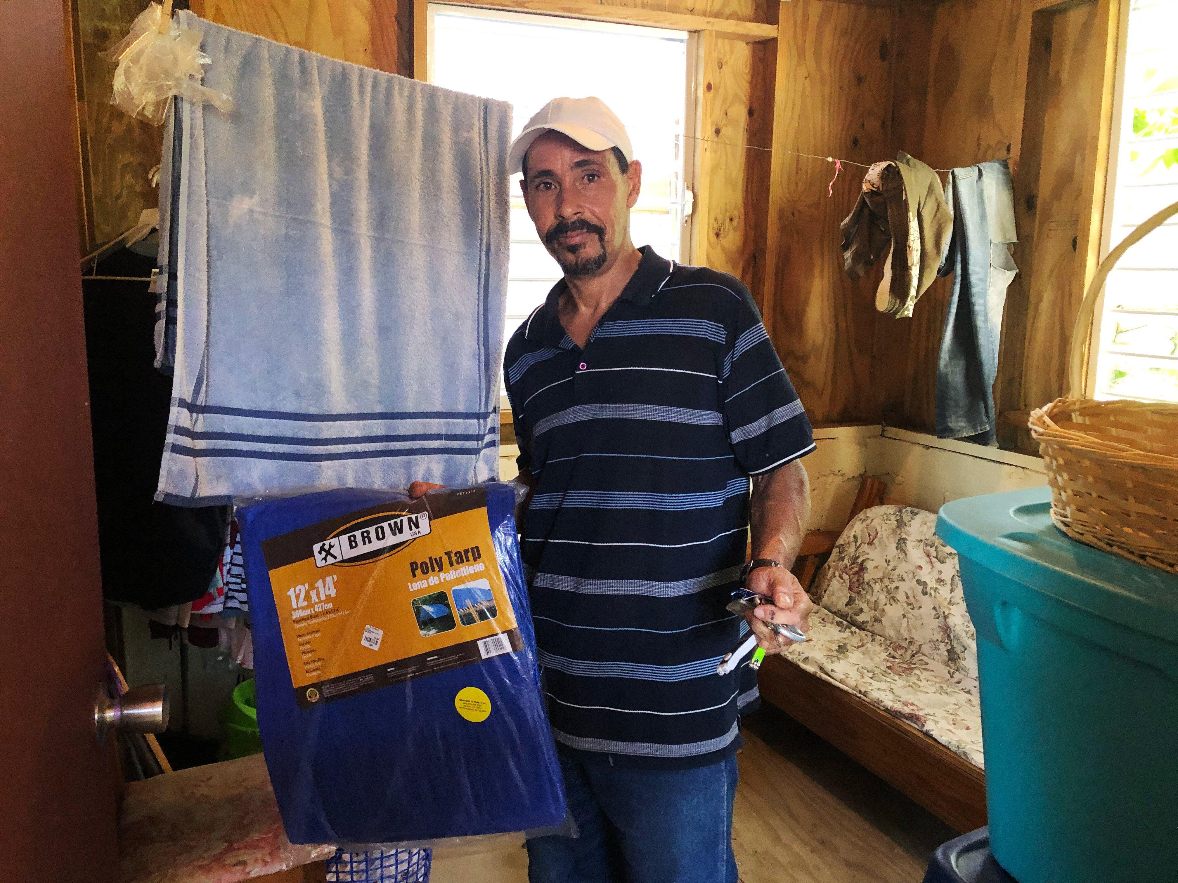 José Antonio Vázquéz purchased a new tarp to prepare for Dorian.