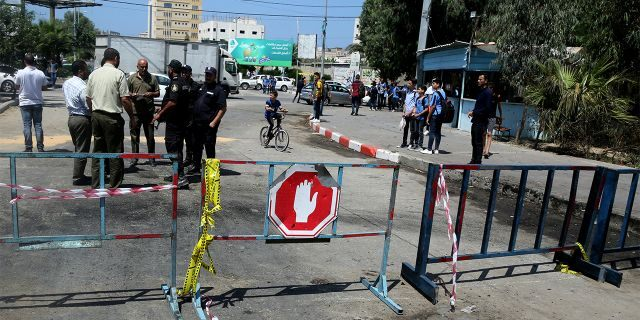 Security forces loyal to Hamas checking the scene following an explosion in Gaza City.