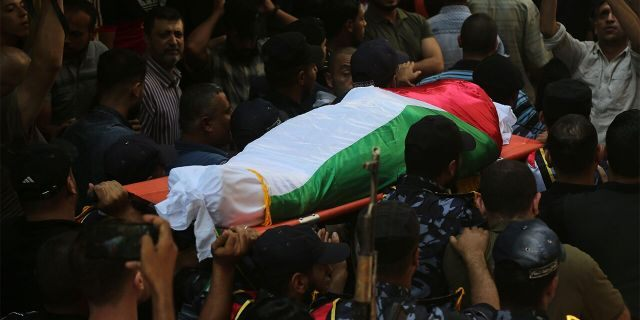 Security forces loyal to Hamas transporting the body of one of the police officers killed during his funeral in Gaza City on Wednesday.