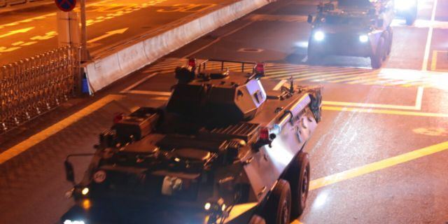 Armored personnel carriers of China's People's Liberation Army (PLA) pass through the Huanggang Port border between China and Hong Kong, Thursday, Aug. 29, 2019.