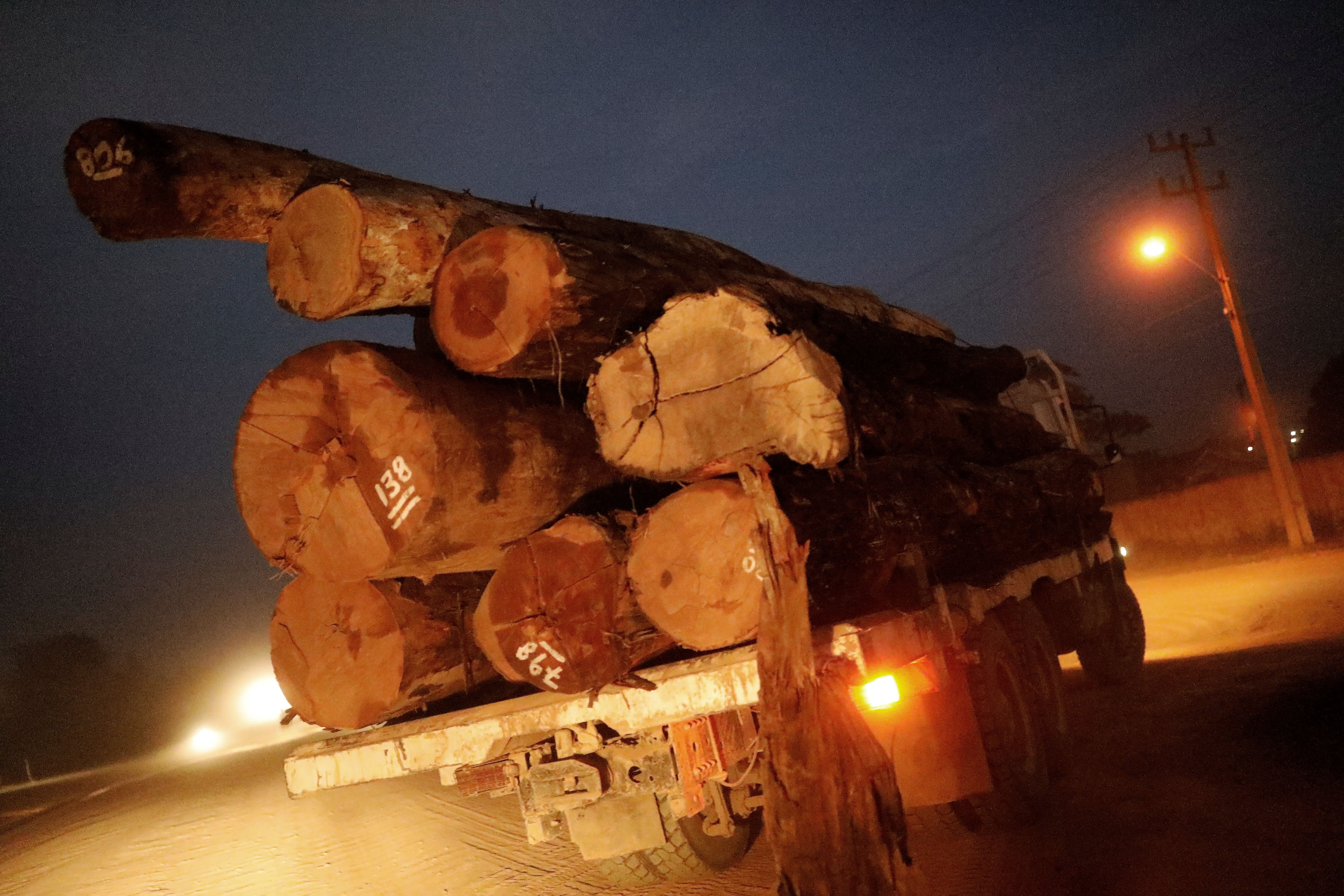 A truck transports logs that were illegally extracted from Amazon rainforest on Tuesday.