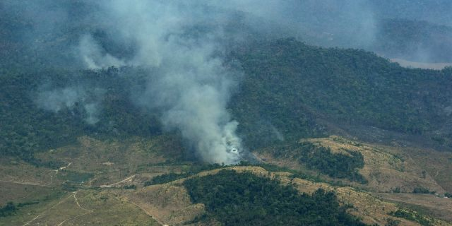 Smoke rises from a rainforest in Altamira, Para state, Brazil, Wednesday, Aug. 28, 2019.