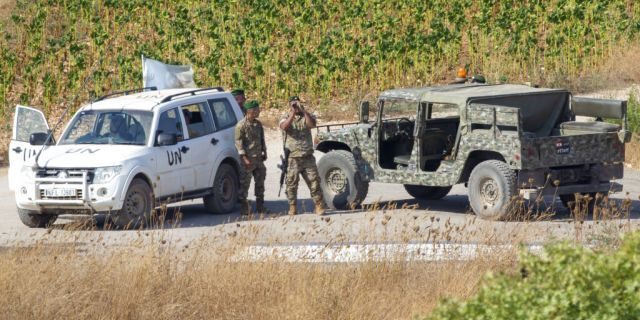 Lebanese soldiers with U.N officials patrol in the southern Lebanese village of Aitaroun along the Israel-Lebanon border, Israel, Tuesday, Aug. 27, 2019.