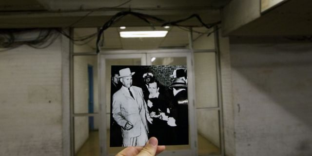 This Sept. 10, 2013 photo shows an image taken by Bob Jackson of the Dallas Times Herald on Nov. 24, 1963, of Lee Harvey Oswald, assassin of U.S. President John F. Kennedy, reacting as Dallas night club owner Jack Ruby, foreground, shoots at him from point blank range in a corridor of Dallas Police Headquarters, juxtaposed with the current scene at the Dallas Police Headquarters, in Dallas. (Associated Press)
