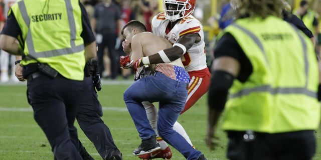Kansas City Chiefs' Harold Jones-Quartey tackles a fan who ran onto the field during the second half of a preseason NFL football game against the Green Bay Packers Thursday, Aug. 29, 2019, in Green Bay, Wis. (Associated Press)