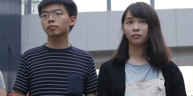 ​​​​​​​Pro-democracy activists Joshua Wong, left, and Agnes Chow address reporters outside a government office in Hong Kong, June 18, 2019. (Associated Press)
