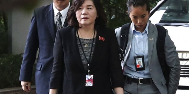 In this June 11, 2018, file photo, North Korean Vice Foreign Minister Choe Son Hui, center, arrives for a meeting with U.S. Ambassador to the Philippines Sung Kim at the Ritz-Carlton Millenia Hotel in Singapore ahead of the summit between U.S. President Donald Trump and North Korean leader Kim Jong Un.