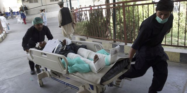 An injured man is carried into a hospital after a car bomb explosion in Kabul, Afghanistan, Thursday, Sept. 5, 2019. A car bomb rocked the Afghan capital on Thursday and smoke rose from a part of eastern Kabul near a neighborhood housing the U.S. Embassy, the NATO Resolute Support mission and other diplomatic missions. (AP Photo/Rahmat Gul)