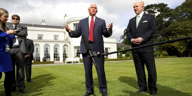 Vice President Pence and U.S. Ambassador to Ireland Edward Crawford speaking at the ambassador's residence in Dublin on Tuesday. (AP Photo/Peter Morrison)