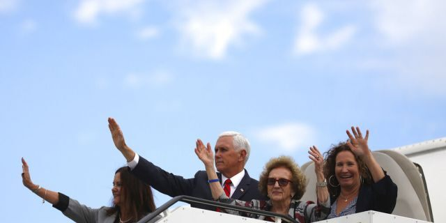 Vice President Pence and members of his family waving goodbye as they board Air Force Two in Dublin on Tuesday. (AP Photo/Peter Morrison)