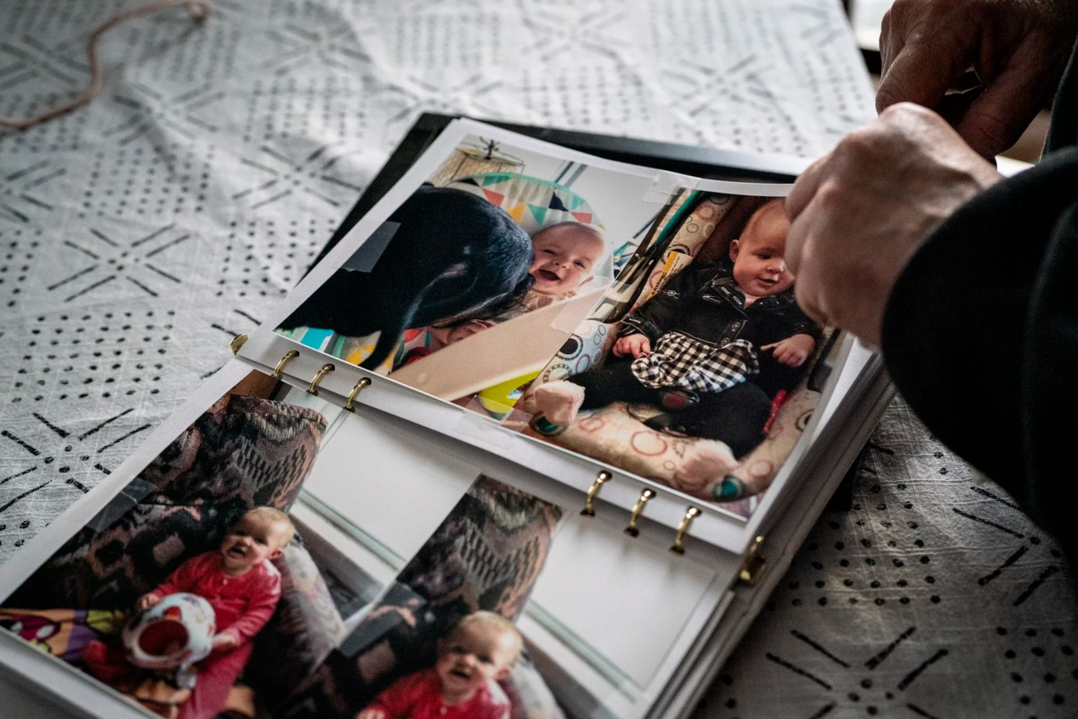 Judy Kennedy flips through pictures of her granddaughter Gabrielle Kennedy at her home in North Berwick, Maine. The baby was