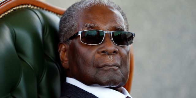 """Zimbabwe's former president Robert Mugabe looks on during a press conference at his private residence nicknamed """"Blue Roof"""" in Harare, Zimbabwe, July 29, 2018. (Reuters)"""