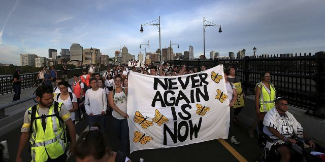 """""""Never Again Is Now"""" protesters rally at the New England Holocaust Memorial and then march across the Longfellow bridge into the Amazon local business building lobby, Thursday, Sept. 5, 2019 in Cambridge, Mass. (Associated Press)"""