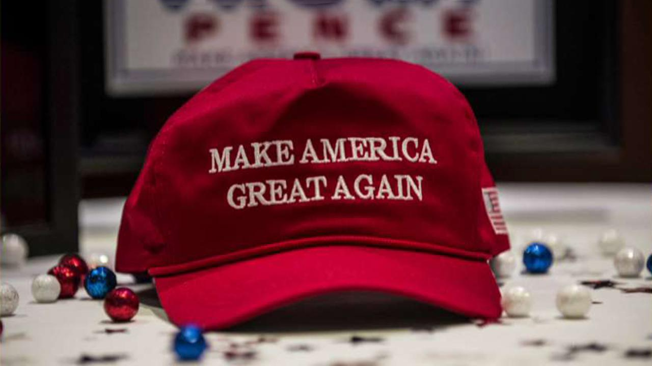Author suggests people shouldn't wear red baseball hats