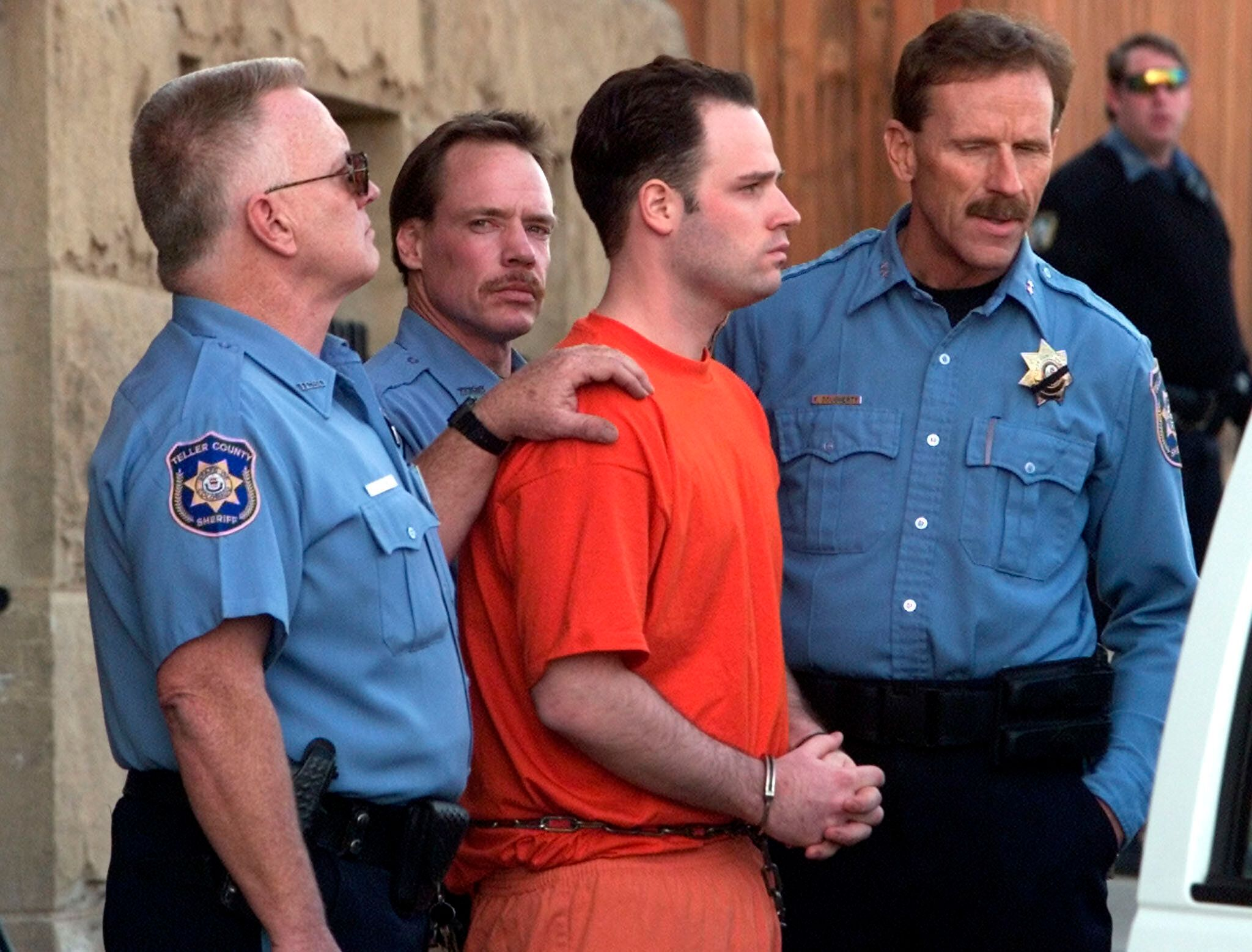 Randy Halprin, one of the Texas 7 prison escapees, is led out of the Teller County Courthouse after an extradition hearing in