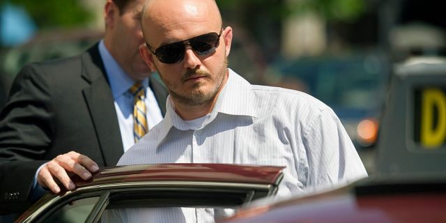 In this June 11, 2014, photo, former Blackwater Worldwide guard Nicholas Slatten leaves federal court in Washington after the start of his trial. (AP Photo/Cliff Owen, File)