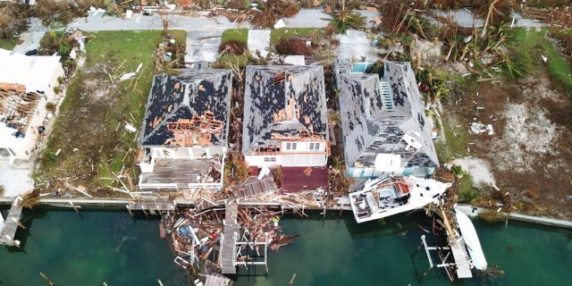 Destruction caused by Hurricane Dorian is seen from the air, in Marsh Harbor, Abaco Island, Bahamas, Friday, Sept. 6, 2019. The Bahamian health ministry said helicopters and boats are on the way to help people in affected areas, though officials warned of delays because of severe flooding and limited access.