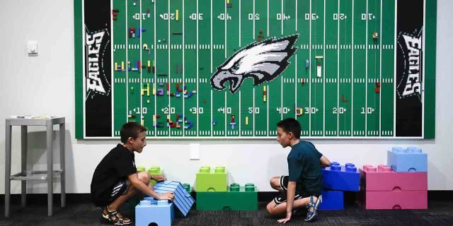 In this Thursday, Aug. 22, 2019, photo, 10-year-old twin brothers Ryan left, and Jack Ykoruk, play in the Lincoln Financial Field sensory room before a preseason NFL football game between the Philadelphia Eagles and the Baltimore Ravens in Philadelphia. (AP Photo/Matt Rourke)