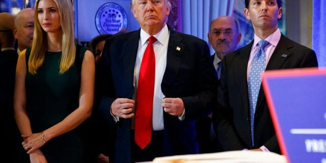 Then-President-elect Donald Trump, center, is flanked by daughter Ivanka Trump and son Donald Trump Jr., at a news conference in the lobby of Trump Tower in New York City, Jan. 11, 2017. (Associated Press)