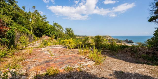 But the cabin was demolished - and the site overlooking Three Cliffs Bay on the stunning Gower Coast in Wales is now going under the hammer.
