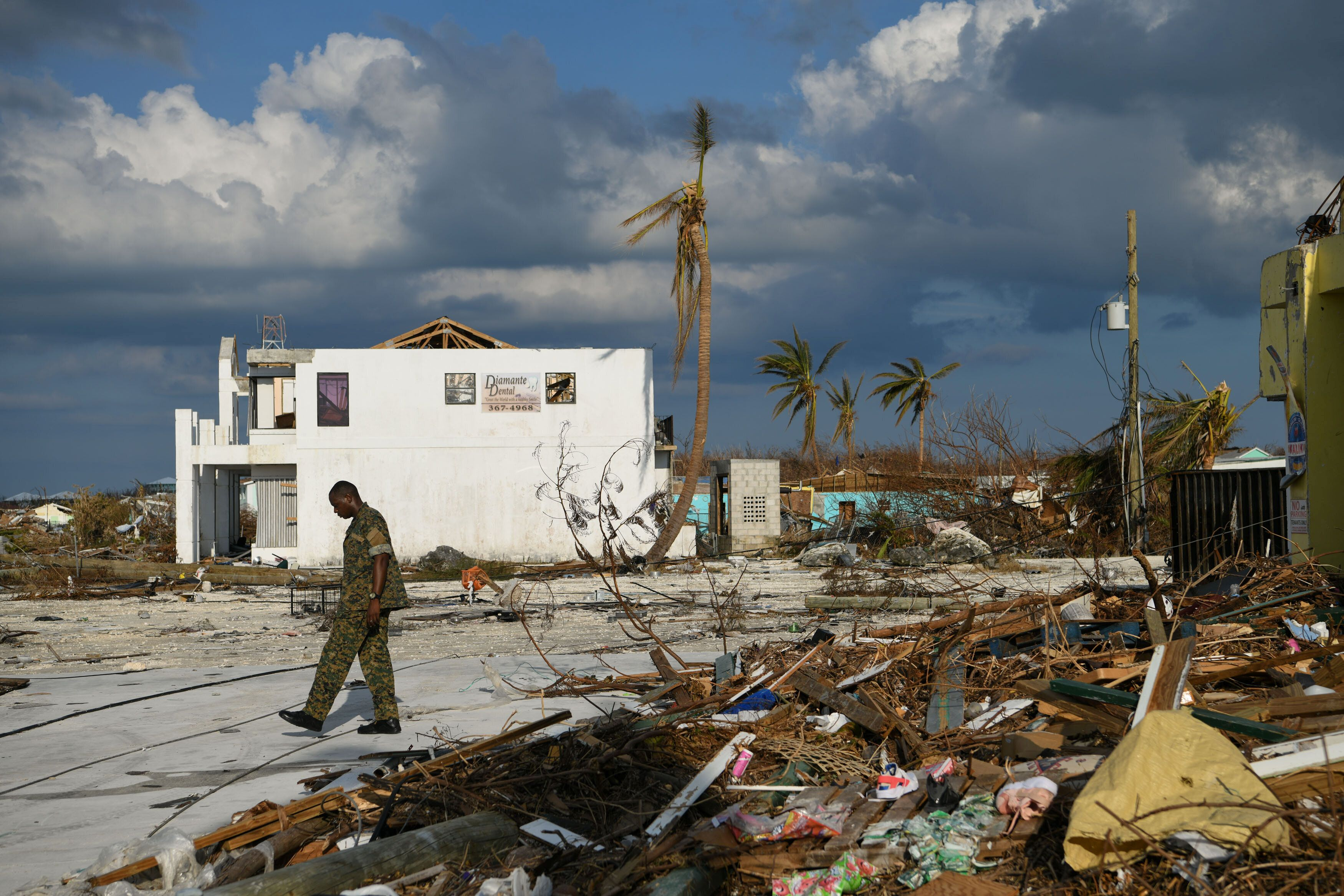 A member of the Bahamian military assesses damage in a destroyed neighborhood in the wake of Hurricane Dorian in Marsh Harbou