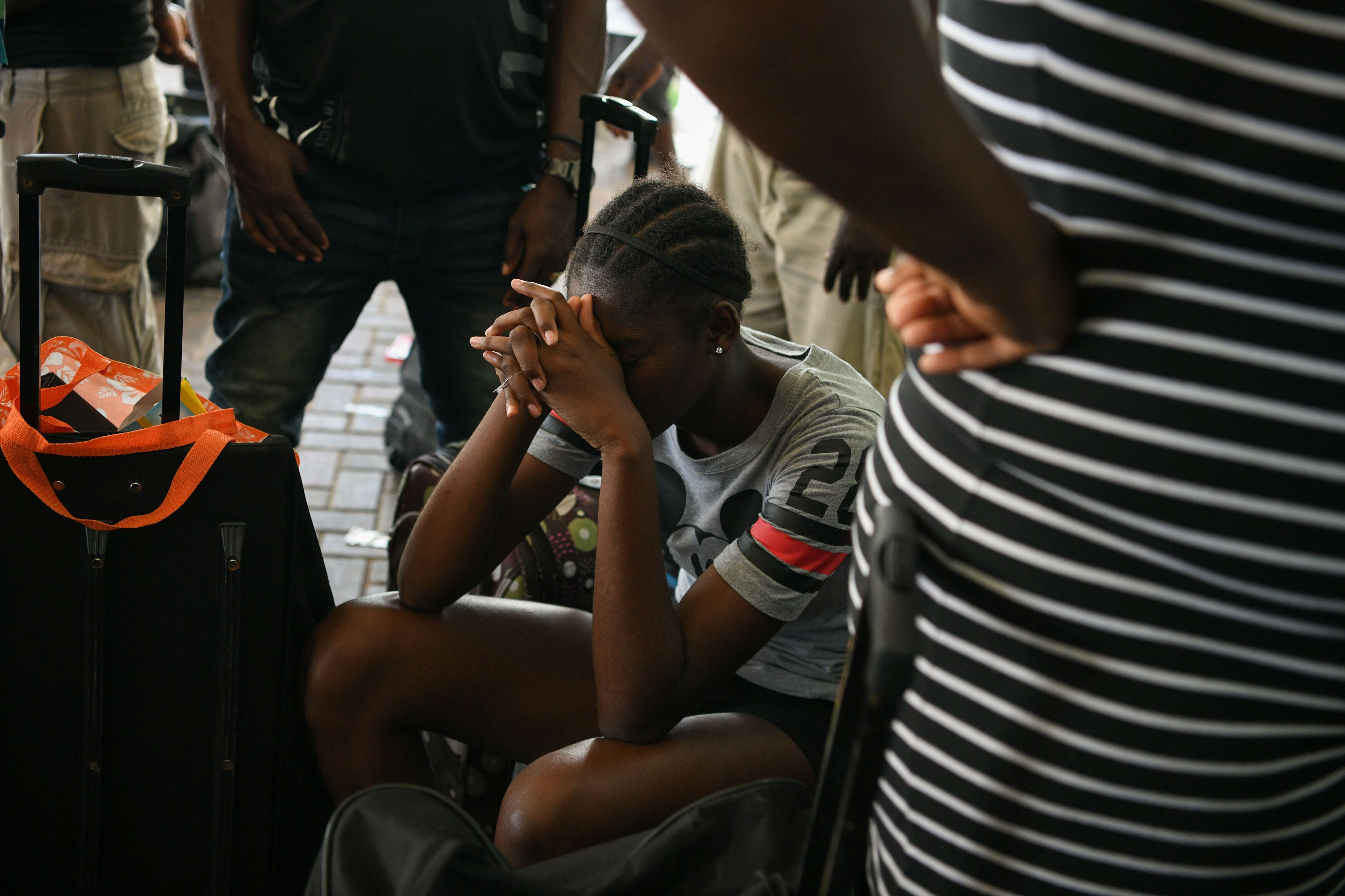 Residents wait at the airport in hopes of evacuating the island in the wake of Hurricane Dorian in Marsh Harbour, Great Abaco