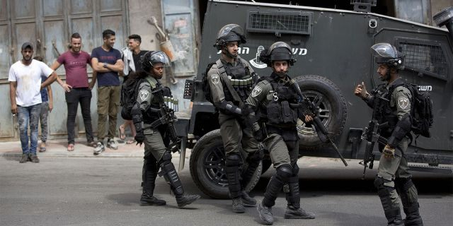 Israeli border police officers in the village of Azzun near the West Bank city of Qalqilya on Saturday.
