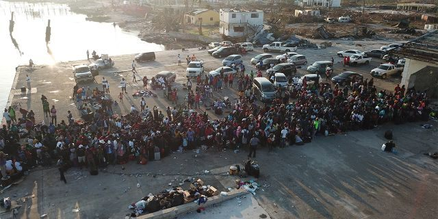 People waiting to be evacuated to Nassau via a ferry at Marsh Harbor Port on Saturday.