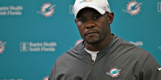 Miami Dolphins head coach Brian Flores takes questions from members of the media during NFL football practice, in Davie, Fla. (Carl Juste/Miami Herald via AP, File)
