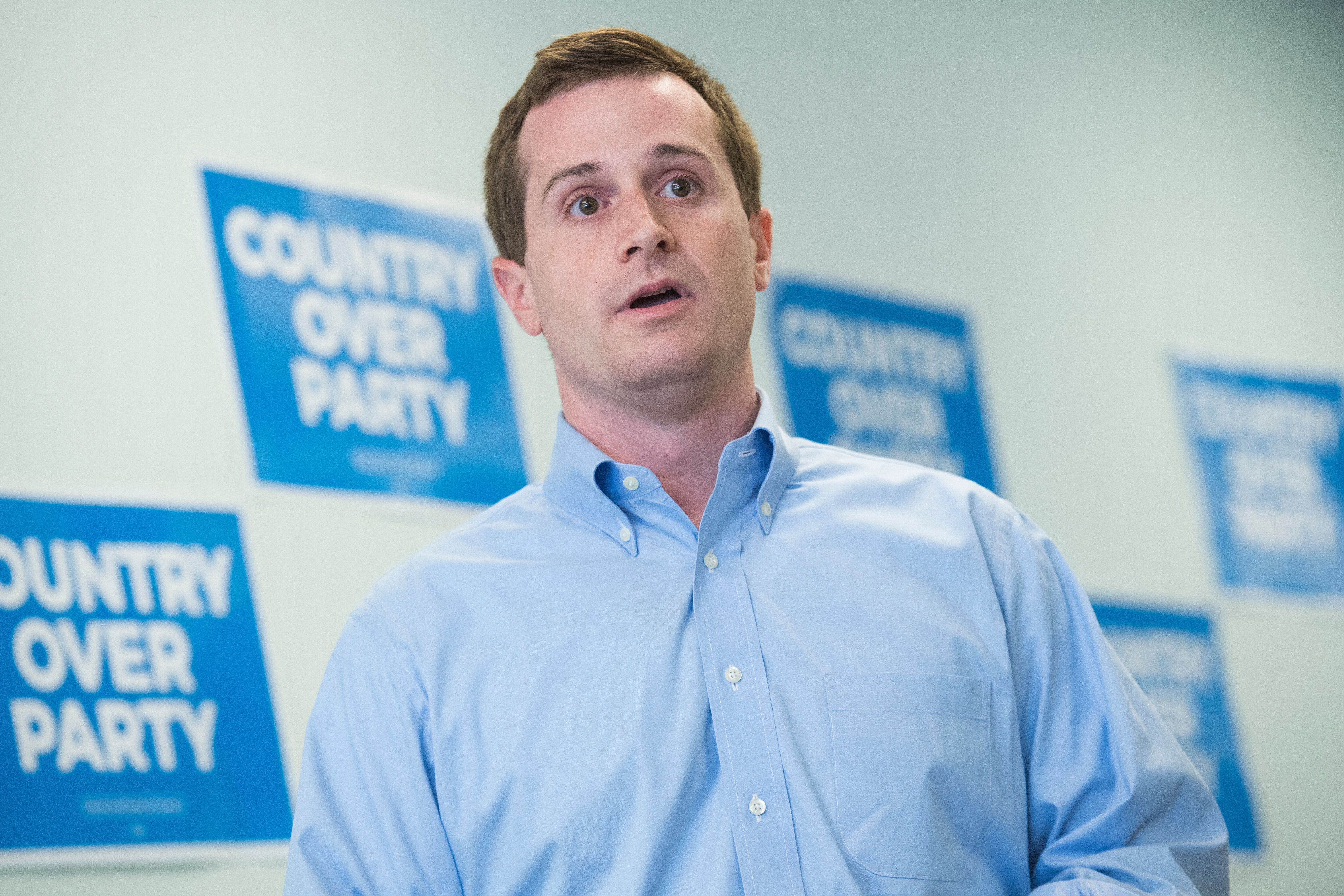 Dan McCready, Democratic candidate for North Carolina's 9th District, talks with voters at his campaign office during his edu