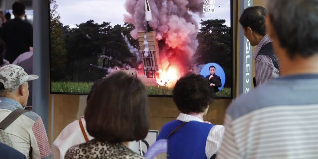 People watch a TV showing a file image of a North Korea's missile launch. (AP Photo/Ahn Young-joon)