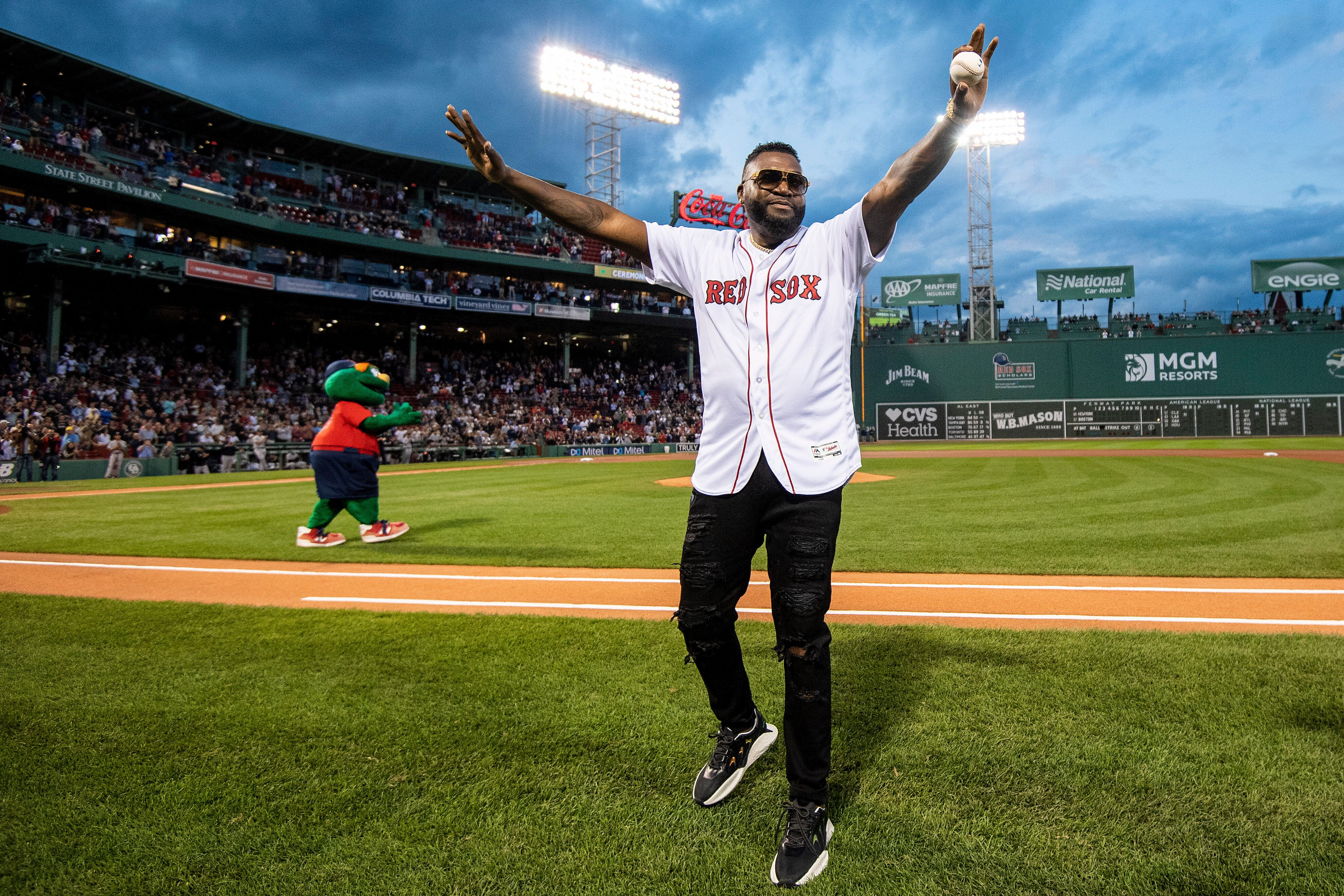 Former designated hitter David Ortiz of the Boston Red Sox is introduced before throwing out a ceremonial first pitch as he r