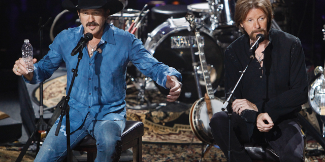 Kix Brooks, left, and Ronnie Dunn of the country music duo Brooks & Dunn, talk about their decision to stop performing together as they answer questions from the audience during a television taping in Nashville, Tenn., on Aug. 12, 2009.(AP Photo/Mark Humphrey)