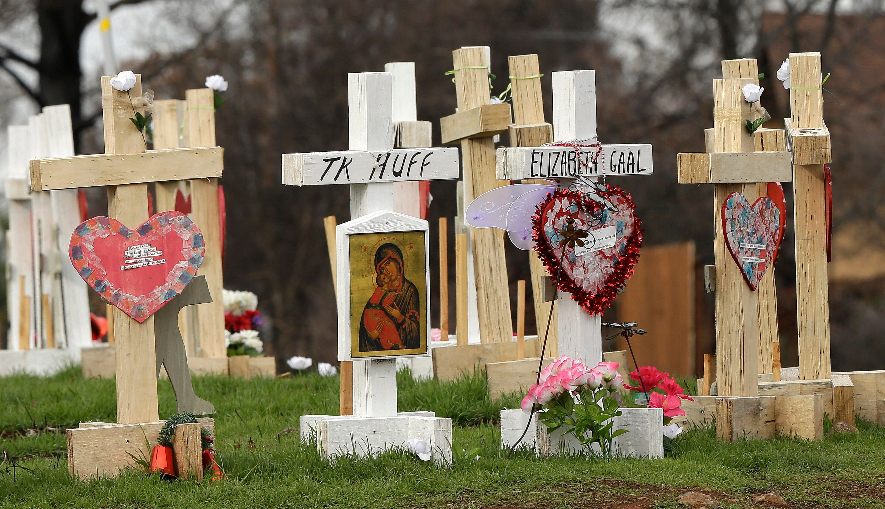 In this Thursday, Feb. 7, 2019, photo, the names of those who died in the Camp Fire are displayed on crosses that make up a m