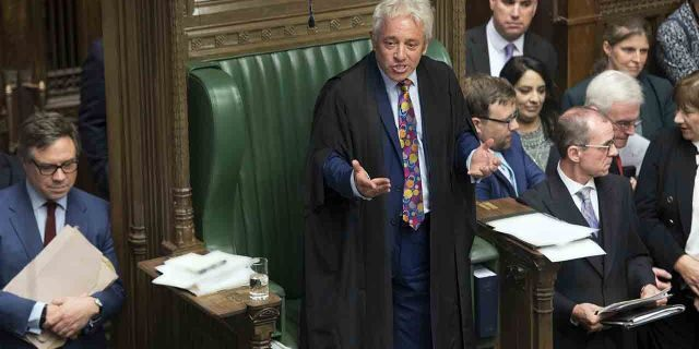 In this handout photo released by the House of Commons, speaker of the House John Bercow gestures after announcing he will be standing down, in the House of Commons in London, Monday, Sept. 9, 2019. A colorful era in British parliamentary history is coming to a close with Speaker of the House John Bercow's abrupt announcement Monday that he will leave his influential post by the end of October. (Jessica Taylor/House of Commons via AP)