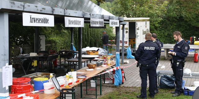 In this Sunday, Sept. 8, 2019 photo police officers investigate a booth after an explosion at a village festival in Freudenberg, Germany.